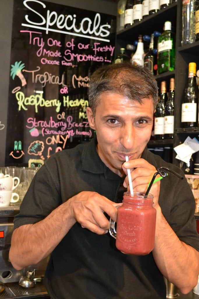 Majid Pour sipping on a Raspberry Heaven smoothie at Caffe Bambino