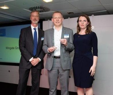 Ben Clarke (centre), managing director of Wingate Group, picking up their FT Adviser award