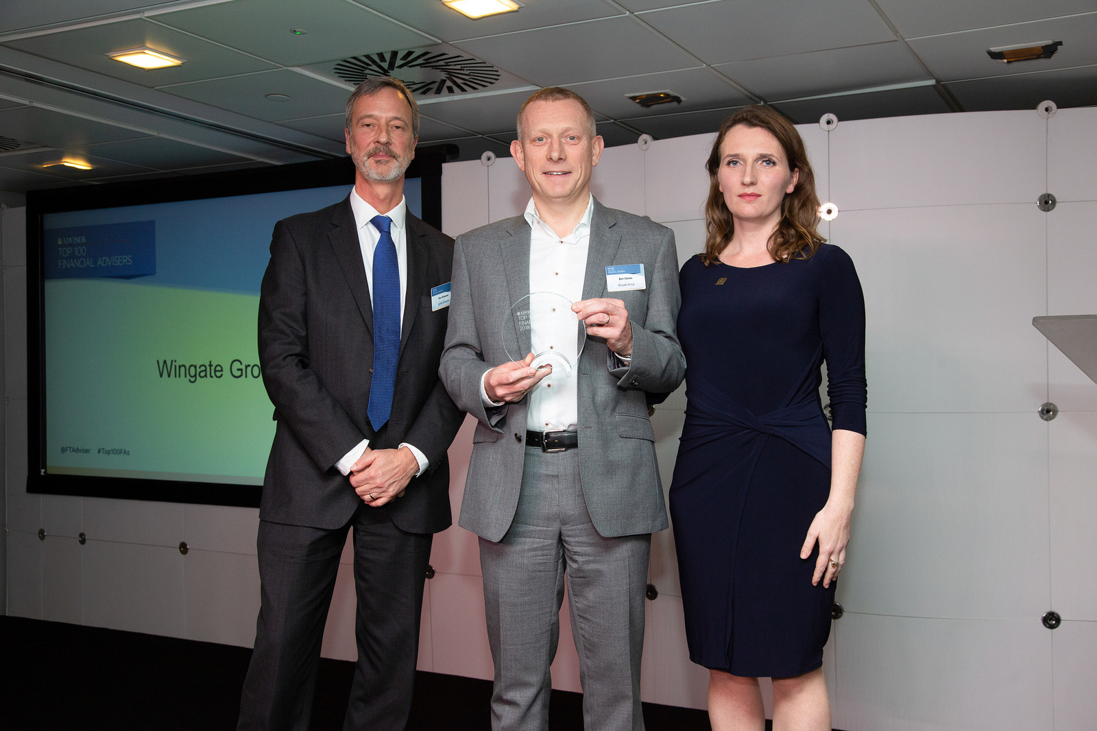 Ben Clarke (centre), managing director of Wingate Group, picking up their FT Adviser award