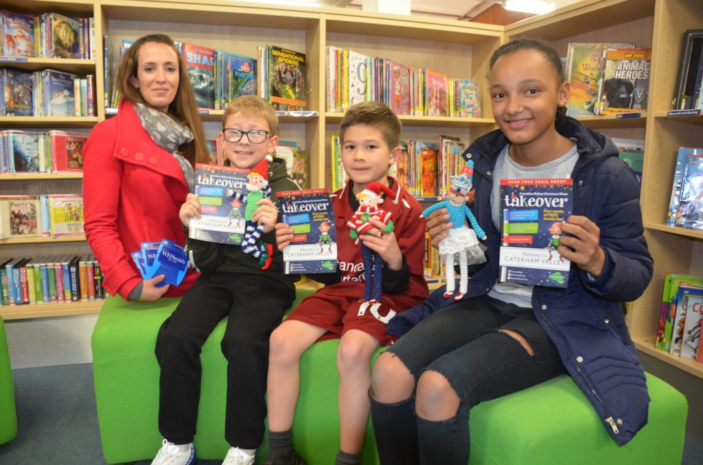 Elf Takeover winners Alfie Fotheringham (8), Harry Drewett (7) and Eve Malcolm (10) receive their prizes from Caterham Valley For You board member Lucie Allan