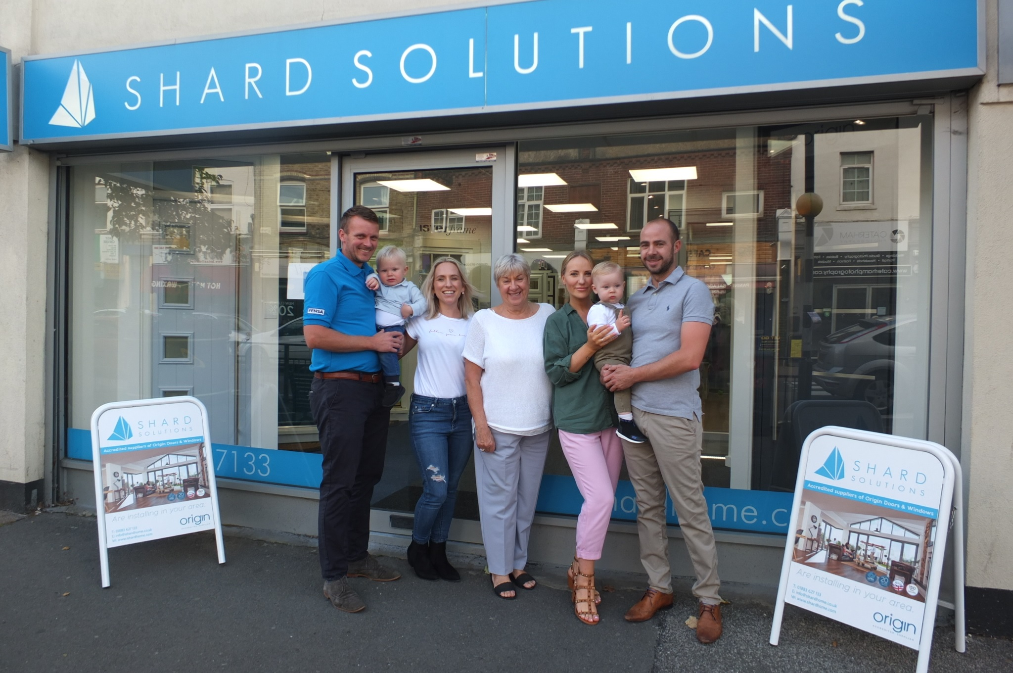 The Shard Solutions family outside their Caterham showroom